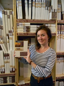 Wet Paint staffer, Meg Nelson, holding one of the small size canvases