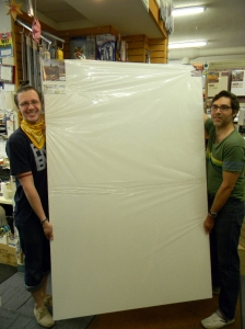 "Wet Paint staffers, Chris and Justin, holding a giant 48x72"" stretched canvas"