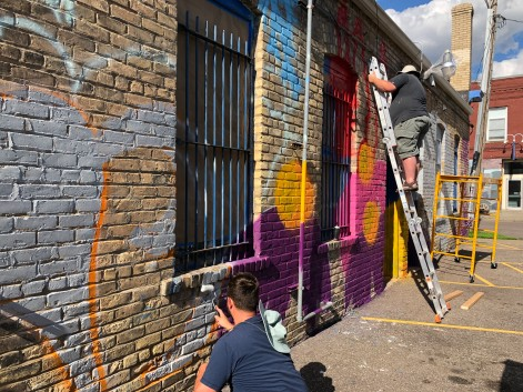 Tucker Russell and Jeff block out the mural