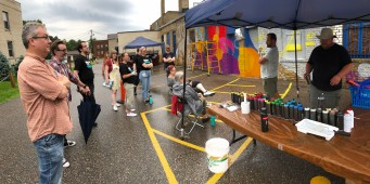 Tucker preps the staff for the Mural Painting Event